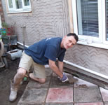 Anthony laying the patio